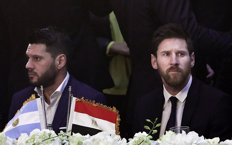 In this Tuesday, Feb. 21, 2017, file photo, FC Barcelona's Lionel Messi, right, attends a gala dinner held at the Mena House in Giza. (AP Photo)
