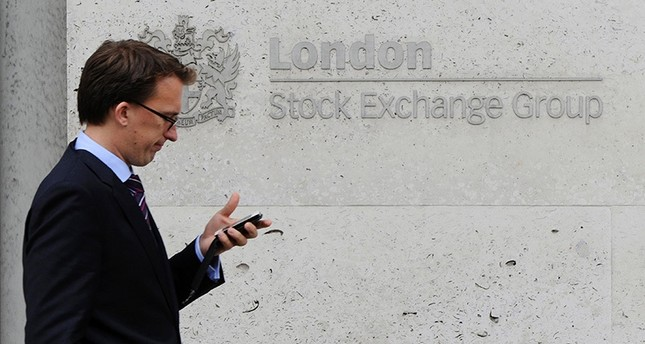 This file photo taken on September 22, 2011 shows a man walking past the London Stock Exchange, in central London. (AFP)