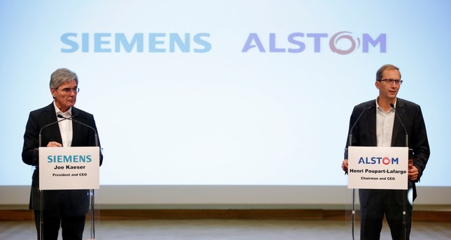 Henri Poupart-Lafarge, CEO of Alstom, and Siemens president and CEO, Joe Kaeser, attend a news conference to announce the deal to merge rail operations in Paris.