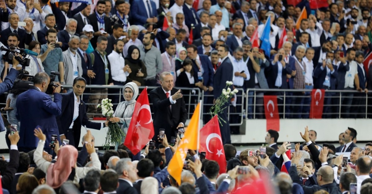 President Recep Tayyip Erdou011fan, with his wife first lady Emine Erdou011fan, greet their supporters as they arrive at a meeting to announce his ruling AK Party's manifesto for the March 2019 local elections, Ankara, May 24, 2018.