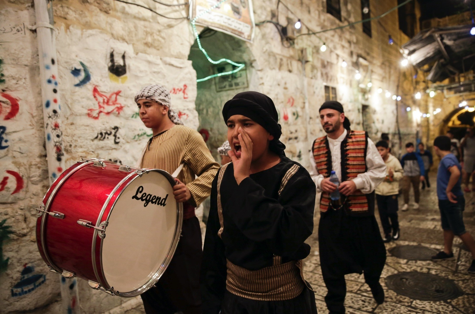 Wakers yell to announce the time for the pre-dawn meal in Jerusalem, June 5.