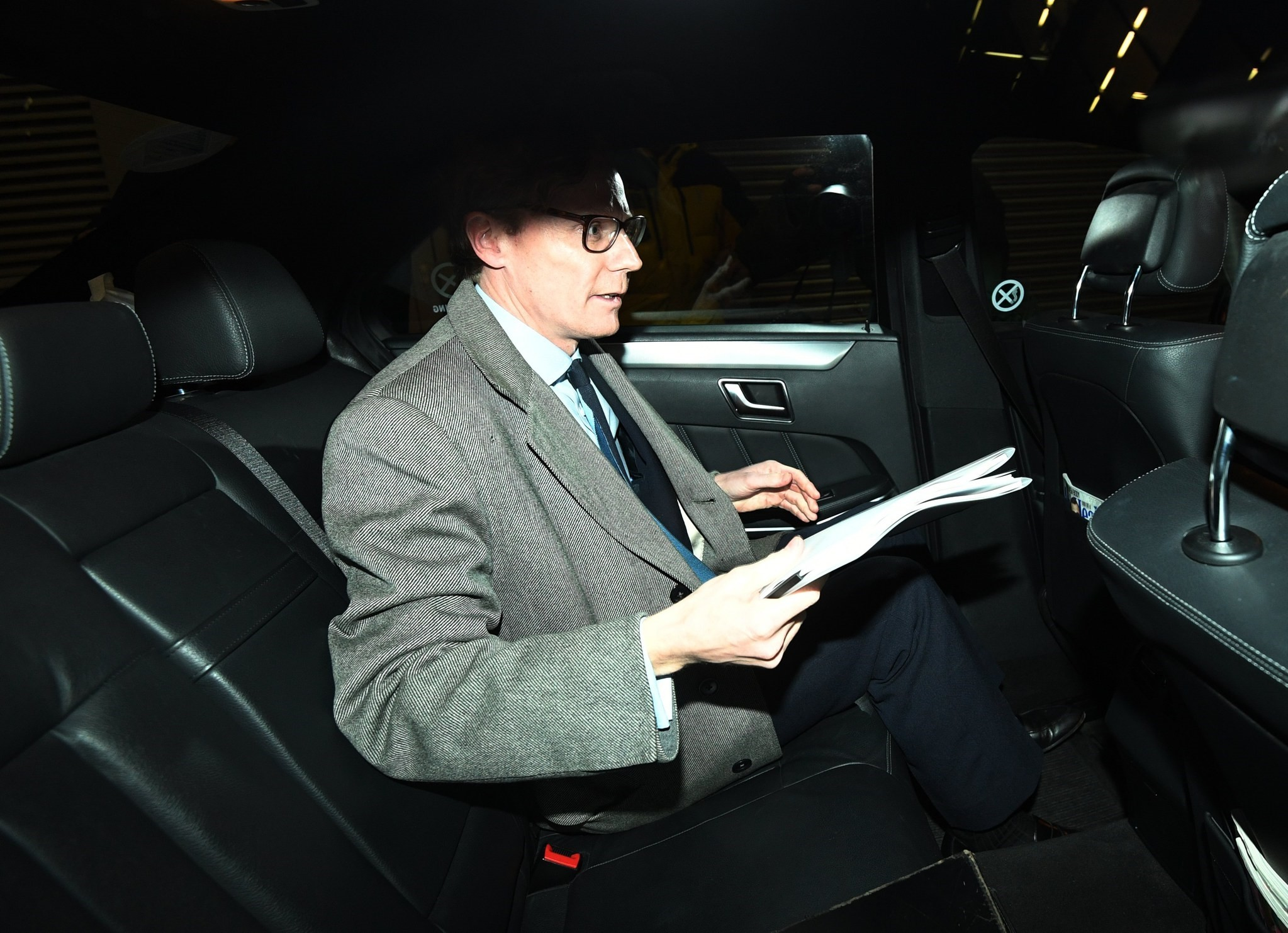 Alexander Nix, CEO of the London-based political consulting firm 'Cambridge Analytica' leaves his offices through the back door in London, March 20, 2018. (EPA Photo)