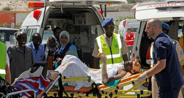 Turkish doctors transport a critically wounded man on a stretcher to a waiting Turkish air ambulance, Mogadishu, Somalia, Oct. 16.