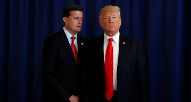 White House Staff Secretary Rob Porter (L) reminds U.S. President Donald Trump he had a bill to sign after he departed quickly following remarks at his golf estate in Bedminster, New Jersey U.S., August 12, 2017. (Reuters Photo)