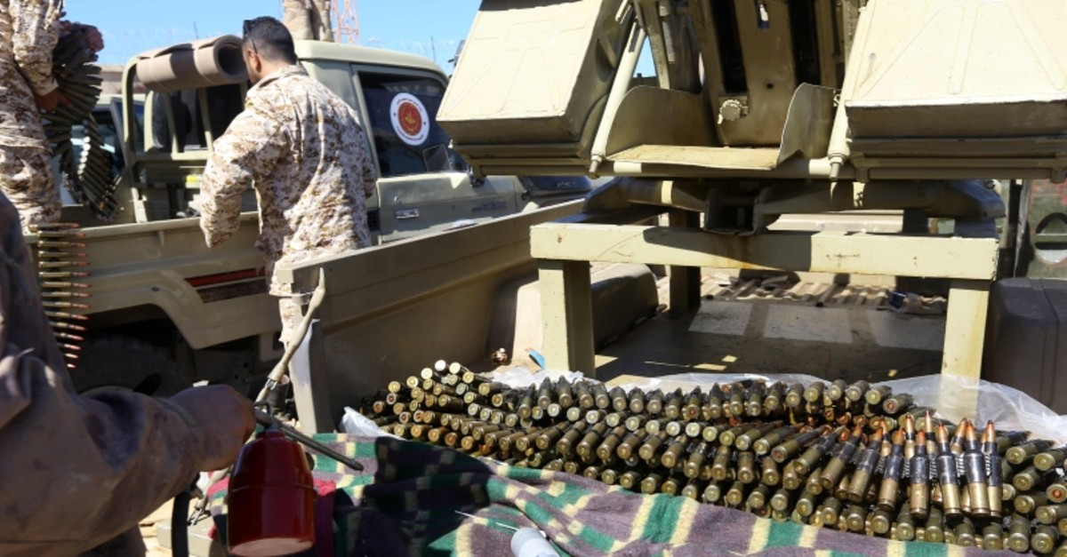 Fighters loyal to the Libyan Government of National Accord (GNA) prepare their ammunition before heading to the frontline as battles against forces of Libyan strongman Khalifa Haftar continue outside the capital Tripoli on April 8, 2019. (AFP Photo)