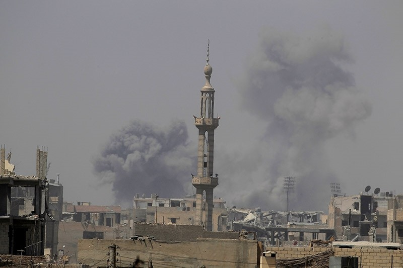 Smoke rises after an air strike during fighting between members of the US-backed Syrian Democratic Forces and Daesh terrorists in Raqqa, Syria August 20, 2017. (Reuters Photo)