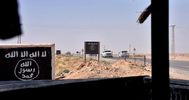 Billboards show the logo of the Daesh terrorist group near the village of al-Malihah, in the countryside of Deir el-Zor, where Assad regime forces are holding a position on Sept. 9, 2017, during the ongoing battle against the terrorists. (AFP Photo)