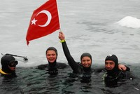 Turkish Derya Can set a new Guinness World Record for the longest freedive under ice on Friday by diving 120 meters horizontally under the frozen surface of Weissensee lake in Austria.