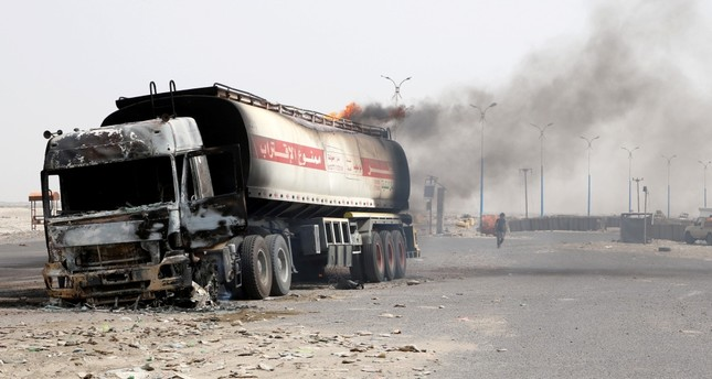 Smoke rises from an oil tanker truck set ablaze during clashes, Aden, Aug. 29, 2019.