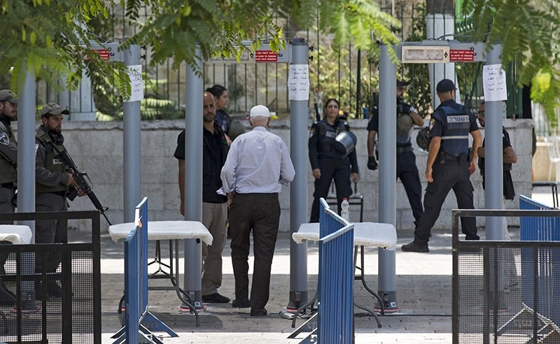 A Palestinian worshipper passes metal detectors installed as new security measures, at the entrance to the Al-Aqsa compound, in Jerusalem, 22 July 2017 (EPA Photo)