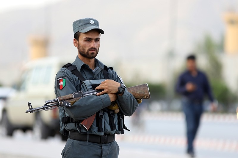 An Afghan security officer secures the scene of a suicide attack near the Ministry of Rural Rehabilitation in Kabul, Afghanistan, July 15, 2018. (EPA Photo)