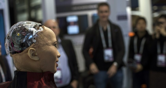 Hanson Robotics' flagship robot Sophia, a lifelike robot powered by artificial intelligence, speaks with visitors at the Mobile World Congress wireless show, in Barcelona, Spain, Feb. 26, 2019.