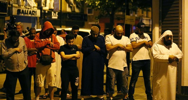 Men pray after a vehicle collided with pedestrians near a mosque in the Finsbury Park neighborhood of North London, Britain June 19, 2017. (REUTERS Photo)