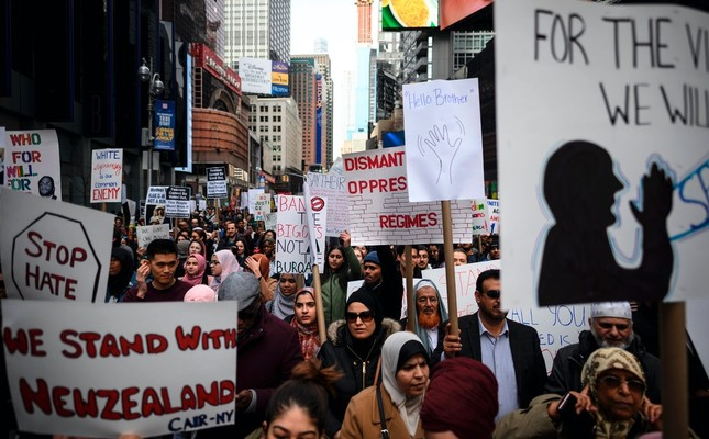 Demonstrators take part in a protest against growing anti-Islam tendencies, white supremacy and anti-immigrant bigotry following the attacks in Christchurch, New Zealand; Times Square, New York City, March 24, 2019.