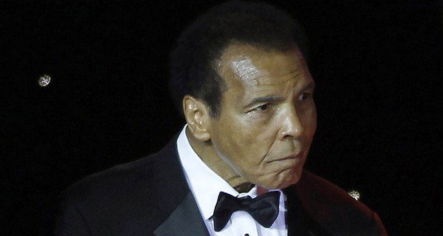 EMuhammed Ali is escorted on stage during The Muhammad Ali Celebrity Fight Night Awards XIX in Phoenix, Arizona in this March 23, 2013 file photo. (Reuters Photo)