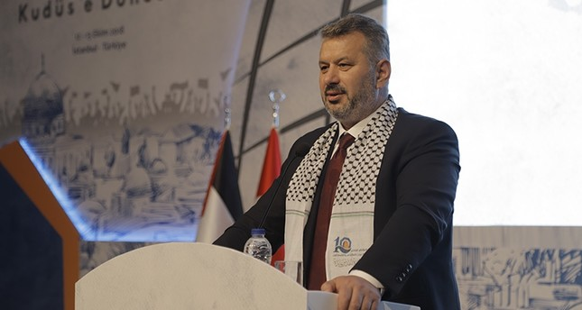 AK Party Istanbul deputy and Turkey-Palestine Inter-Parliamentary Friendship Group Chairman Hasan Turan speaks at the International Conference on the Muslim Ummah in Istanbul on Oct. 14, 2018. (AA Photo)