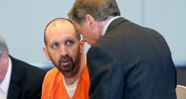 In this March 14, 2017, file photo, Craig Hicks, center, charged with the murder of three Muslim students in Chapel Hill, N.C., listens to with attorney Steve Freedman as he makes an appearance in a Durham County courtroom in Durham, N.C. (AP Photo)