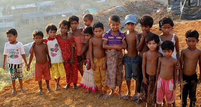 Rohingya children pose for a photograph at the top of the Balukhali camp in Ukhiya, Bangladesh, Sept. 15, 2017. EPA Photo