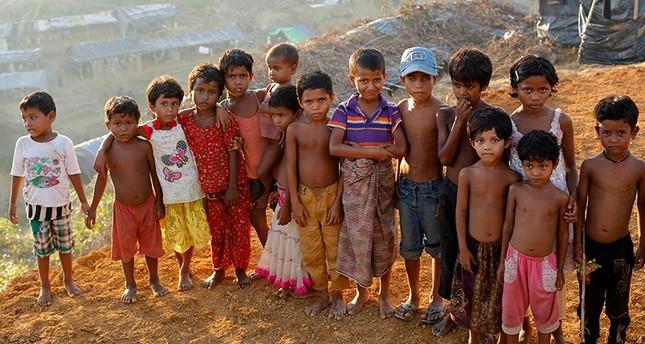 Rohingya children pose for a photograph at the top of the Balukhali camp in Ukhiya, Bangladesh, Sept. 15, 2017. (EPA Photo)