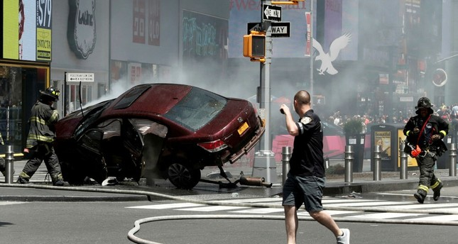 A vehicle that struck pedestrians and then crashed into protective bollards seen on the sidewalk in Times Square in New York City, May 18.
