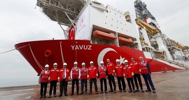 Turkey's Energy Minister Fatih Dönmez and the other officials pose in front of the Turkish drilling vessel Yavuz at Dilovası port in the northwestern Kocaeli province, Turkey, June 20, 2019. Reuters Photo