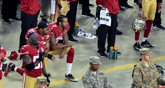 Trump calls on NFL to fire 'son of a b***h' anthem protesters