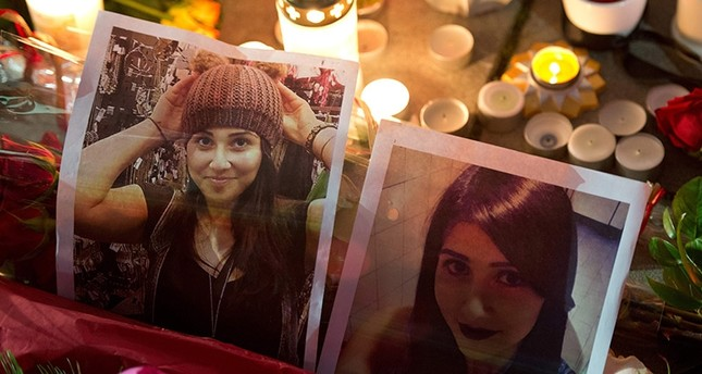 This file photo taken on November 28, 2014 shows candles placed by mourners around pictures of Tuğçe Albayrak in front of a hospital in Offenbach, western Germany, where the young woman was getting medical treatment and where she died. (AFP Photo)
