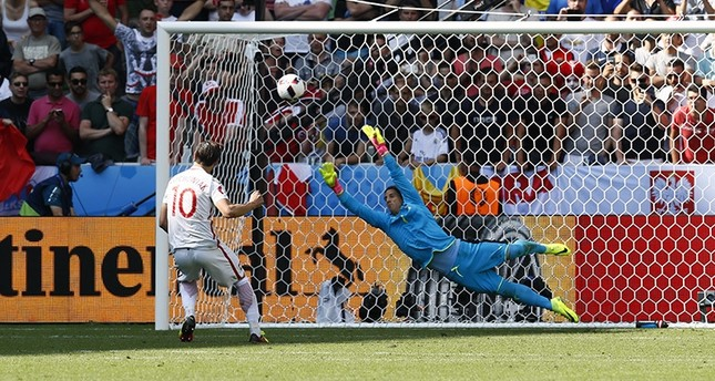 Poland's Grzegorz Krychowiak scores during the penalty shootout to win the match Reuters Photo