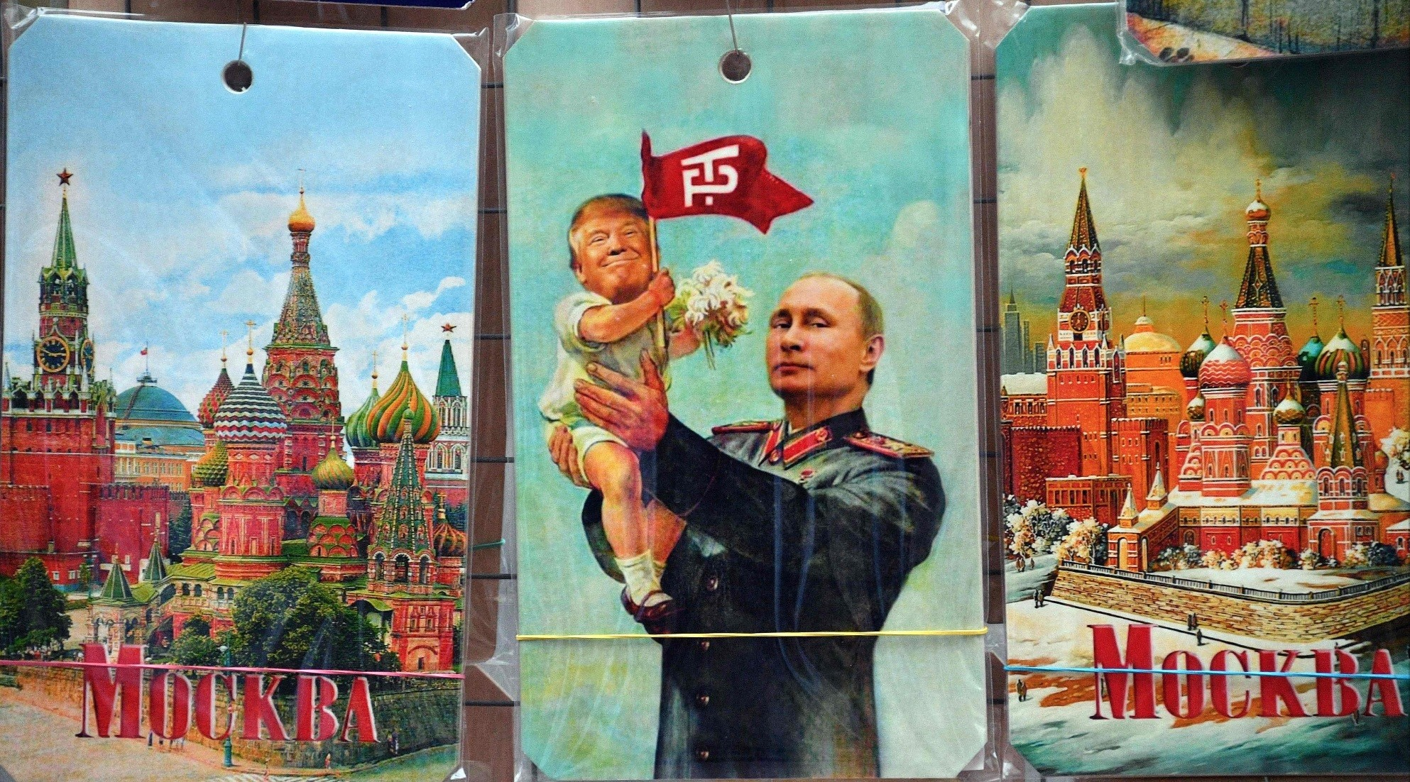 A souvenir kiosk offers a drawing depicting Russian President Vladimir Putin holding a baby with the face of U.S. President Donald Trump, based a propaganda poster showing late soviet leader Joseph Stalin holding a baby, in Moscow, July 5.