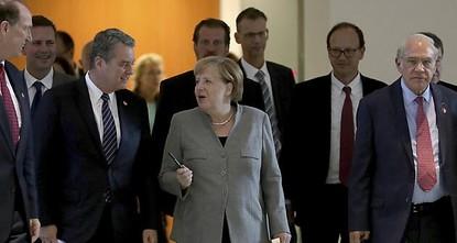 Merkel und IWF: Weltwirtschaft in schwieriger Lage