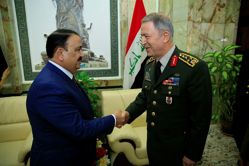 Iraqi Defense Minister Irfanu00a0al-Hayali and Turkish Chief of General Staff Akar meet in Baghdad on March 1, 2018. (AA Photo)