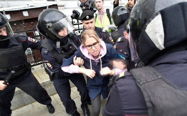 Police officers detain an opposition candidate and lawyer at the Foundation for Fighting Corruption Lyubov Sobol in the center of Moscow, Russia, Saturday, Aug. 3, 2019. (AP Photo)
