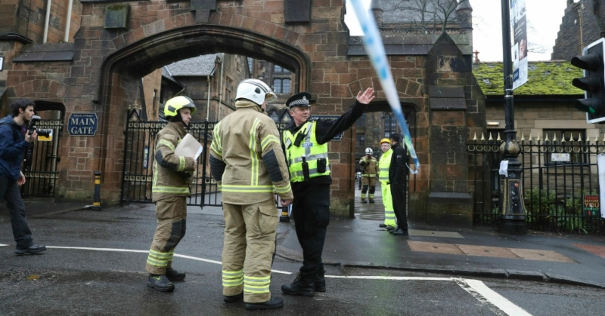 Police and fire services outside the University of Glasgow after the building was evacuated when a suspect package was found in the mailroom, in Glasgow, Scotland, Wednesday March 6, 2019. (AP Photo)