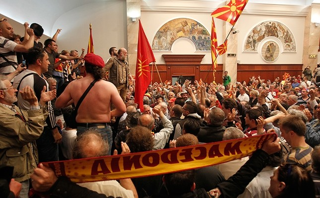 In this April 27, 2017 file photo, protesters enter the parliament building in Skopje, Macedonia. (AP Photo)