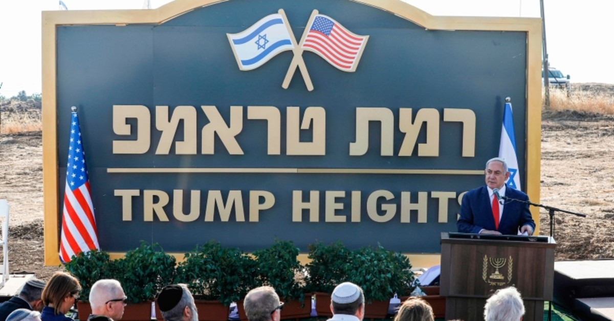 Israeli PM Benjamin Netanyahu gives a speech before the newly-unveiled sign for the new settlement of ,Trump Heights,u201d named after U.S. President Donald Trump, during an official ceremony in the Israeli-annexed Golan Heights on June 16, 2019. (AFP)