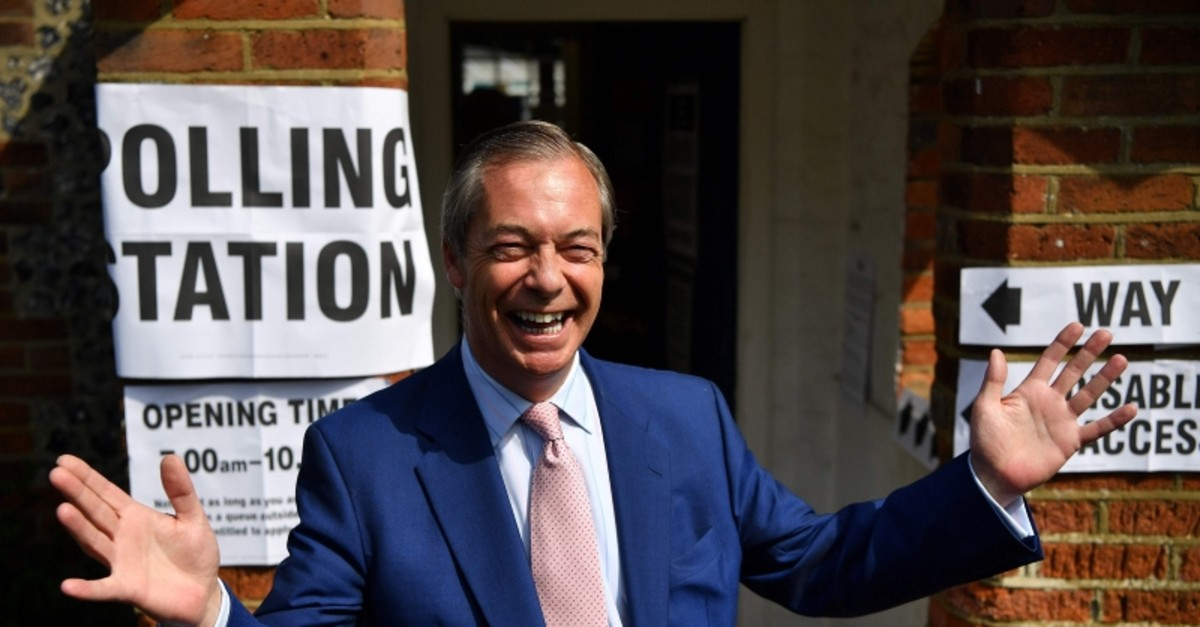 Brexit Party leader Nigel Farage gestures as he arrives at a polling station to vote in the European Parliament elections, in Biggin Hill, south east England on May 23, 2019. (AFP Photo)