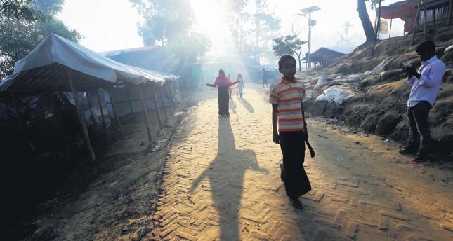 Rohingya refugees walk inside the Palong Khali refugee camp near Cox's Bazar, Bangladesh, Oct. 23.