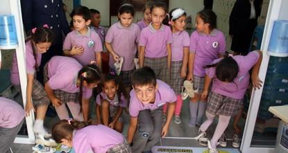 'Shoeless school' follows domestic tradition