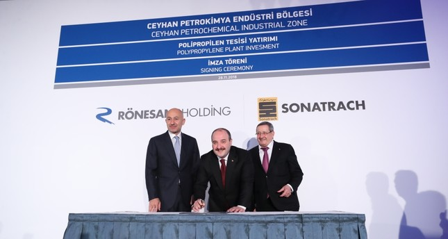 Industry and Technology Minister Mustafa Varank (C), Rönesans Holding Chairman Erman Ilıcak (L) and Algeria's Sonatrach CEO Abdelmoumen Ould Kaddour (R) attend the signing ceremony for the construction of a polypropylene production plant in Adana