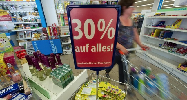 A woman pushes a shopping cart in a Schlecker XL store, Fellbach, Germany.