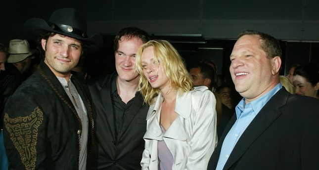 In this file photo taken on April 7, 2004 actress Uma Thurman and Miramaxs' Harvey Weinstein (R) talk at the after-party for Miramaxs' Kill Bill Vol. 2 at The Ivar in Los Angeles, California. (AFP Photo)