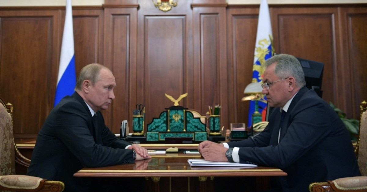 Russia's President Vladimir Putin (L) and Defence Minister Sergei Shoigu attend a meeting to discuss a recent incident with a Russian deep-sea submersible, which caught fire in the area of the Barents Sea, in Moscow, July 2, 2019. (REUTERS Photo)