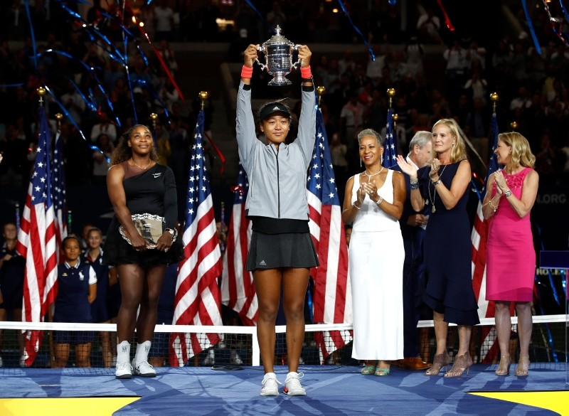 Naomi Osaka of Japan poses with the championship trophy after winning the Women's Singles finals match against Serena Williams of the US in 2018 US Open at the USTA Billie Jean King National Tennis Center on Sept. 8, 2018 in NYC. (AFP Photo)