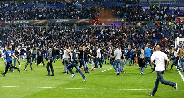 Supporters invade the pitch before the UEFA Europa League quarter final, first leg soccer match between Olympique Lyon and Besiktas Istanbul. (EPA Photo)
