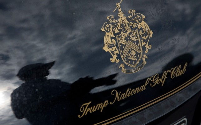 In this Tuesday, June 7, 2016 file photo, a photographer reflected in a golf cart at the the Trump National Golf Club Westchester in Briarcliff Manor, N.Y. AP Photo