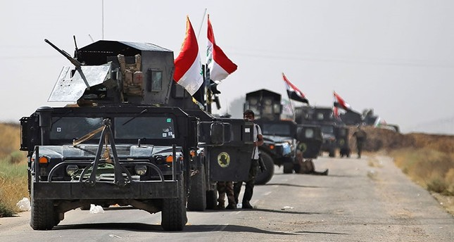 Vehicles of the Iraqi forces and Hashd al-Shaabi (Popular Mobilisation) paramilitaries are seen on the advance towards the Daesh's stronghold of Hawija on October 3, 2017, to recapture the town from the terrorist group. (AFP Photo)