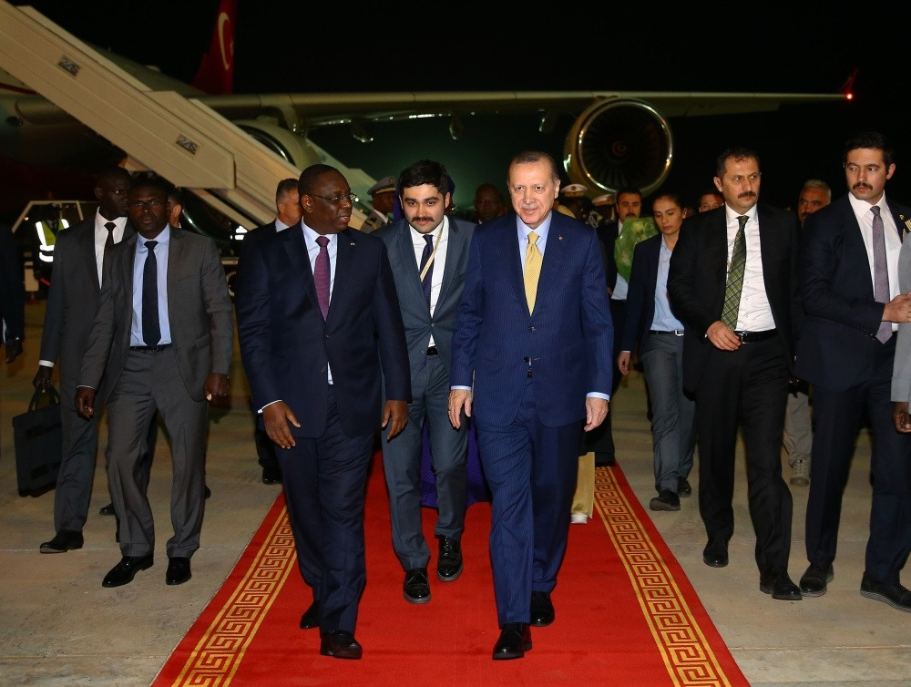 Senegalese President Macky Sall (L) welcomes President Erdou011fan (R) upon his arrival in Senegal, late Wednesday, Feb. 28.