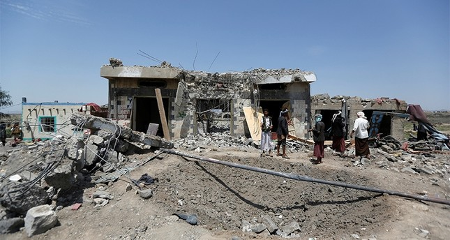 People stand at the site of Saudi-led air strikes in Arhab area, around 20 kilometres (13 miles) north of Sanaa, Yemen August 23, 2017 (Reuters Photo)
