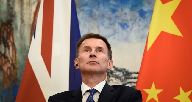 Britain's Foreign Secretary Jeremy Hunt attends a joint press conference with China's Foreign Minister Wang Yi (not pictured) at the Diaoyutai State Guesthouse in Beijing on July 30, 2018. (AFP Photo)
