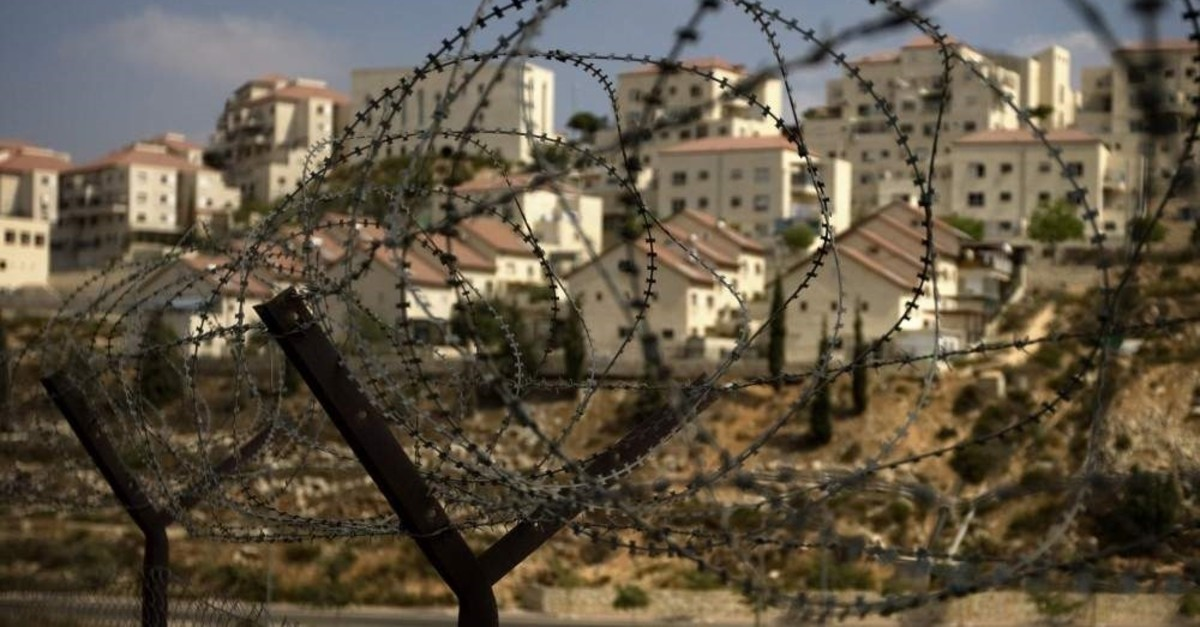 The West Bank Jewish settlement of Beitar Ilit seen through a barbed wire fence, Sept. 4, 2009. (AP Photo)